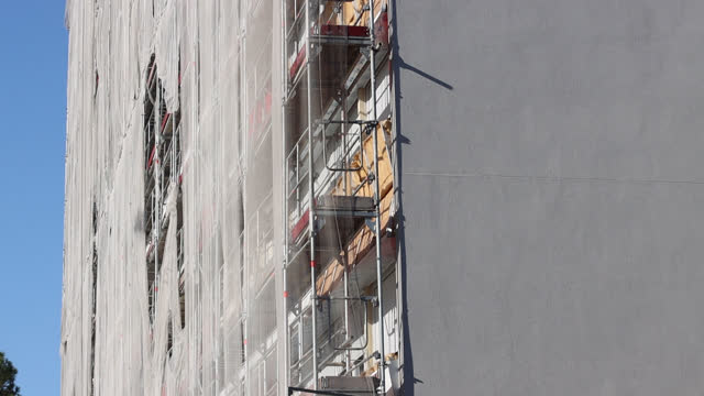 thermal insulation on building facade - scaffolding stock videos & royalty-free footage