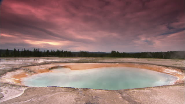 ws thermal pool in barren landscape under overcast sky in yellowstone national park / wyoming, usa - geyser stock videos & royalty-free footage