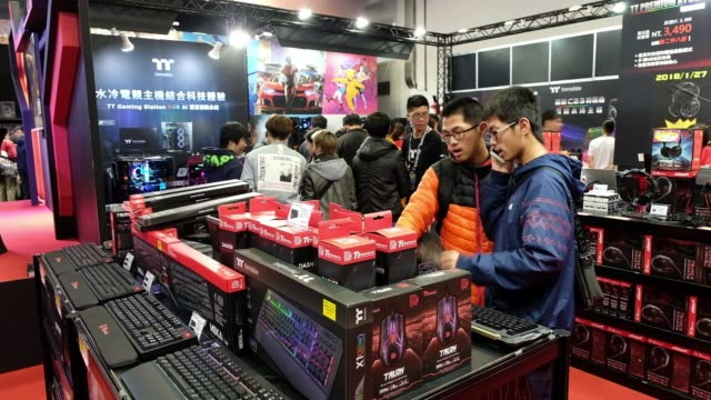 thermaltake technology co ttesports cronos riing rgb 71 gaming headsets hang on display during the 2018 taipei game show in taipei taiwan on friday... - game show stock videos & royalty-free footage
