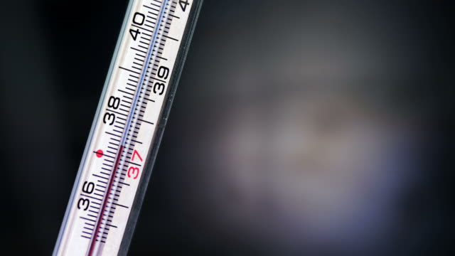 thermometer measures the fever rising - thermometer stock videos & royalty-free footage
