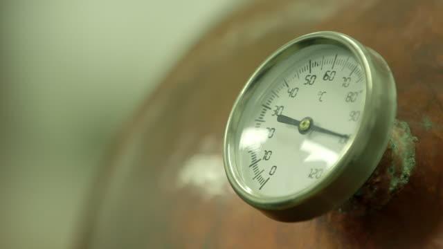 cu of thermometer on still in distillery - distillery still stock videos and b-roll footage