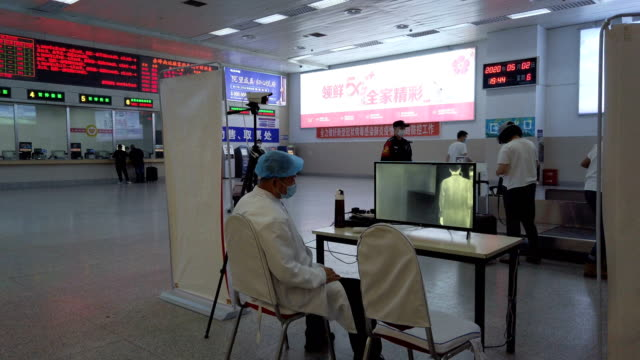 thermoscan infrared camera at entrance department train station for measuring body temperature - manchuria region stock videos & royalty-free footage