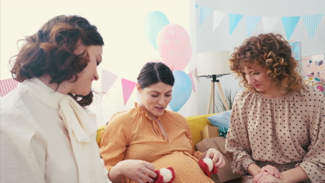 these baby booties are so small! - baby shower video stock e b–roll