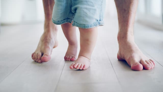 these feet were made for walking - primi passi video stock e b–roll