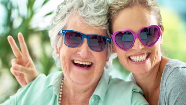 these gals always have a laugh together - sunglasses stock videos & royalty-free footage
