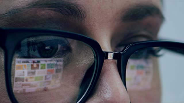 these spectacles protect my eyes when looking at a screen - occhiali da vista video stock e b–roll