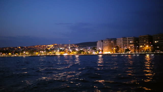 thessaloniki city lights from the boat - thessalonika stock videos & royalty-free footage