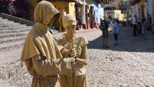 They are a couple depicting a religious concept For a while now human statues are tourist attractions in Cuban famous places such Trinidad and Old...