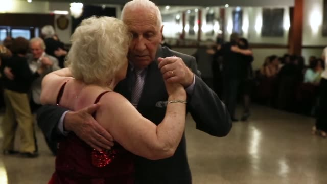 they are in their ninth decade of life but the rhythm of tango still thrills in the legs of oscar and nina - rhythm stock videos and b-roll footage