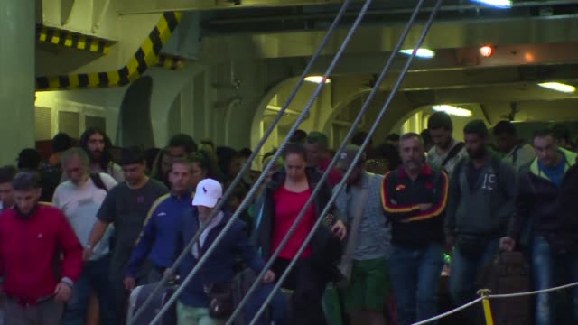 they arrive full of hope and ambition to idyllic greek islands having fled war and other perils however once in athens the migrants from syria... - greece stock videos & royalty-free footage