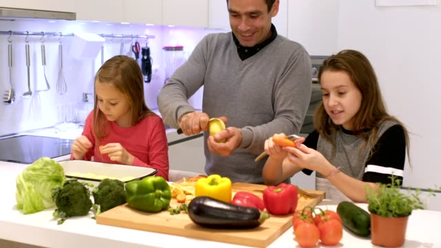 they love cooking together - peeling food stock videos & royalty-free footage