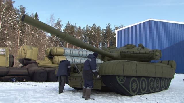 they may look like real tanks and missiles but some of the weapons in russia's arsenal may not all be what they seem khotkovo russia - inflatable stock videos & royalty-free footage