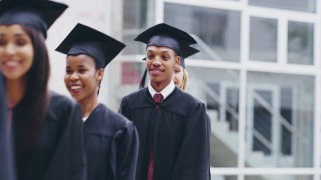they serve as an encouragement to others in their lives - graduation stock videos & royalty-free footage