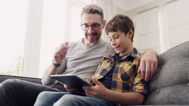 they've downloaded so many fun-filled games to play together - one parent stock videos & royalty-free footage