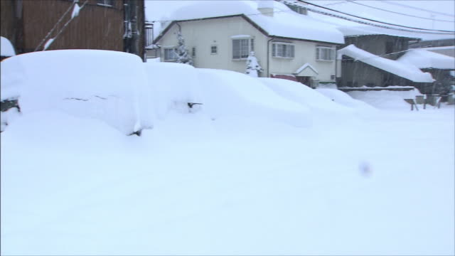 thick accumulation of snow on roofs and cars - thick stock videos & royalty-free footage
