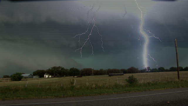 thick bolt of lightning strikes through gathering storm clouds melvin texas 14 may 2008 - lightning strike stock videos and b-roll footage