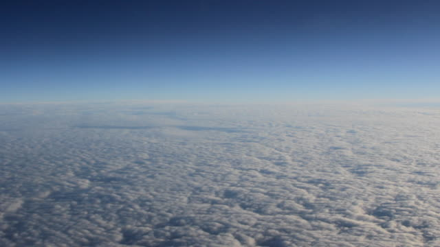 AERIAL A thick cloud deck in blue sky