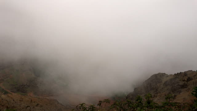 thick clouds descending on kauai island - butte rocky outcrop stock videos & royalty-free footage