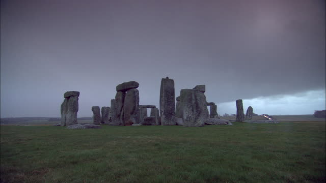 thick clouds fill the sky above stonehenge. - obelisk stock videos & royalty-free footage