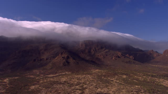 thick clouds float over the mountains near cabo san lucas. available in hd. - cabo san lucas stock videos & royalty-free footage