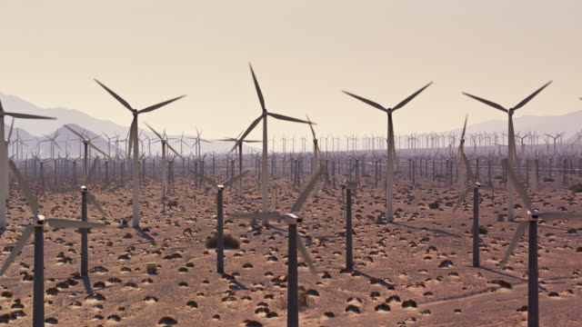 Thick Cluster of Spinning Wind Turbines at San Gorgonio Pass Wind Farm - Drone Shot