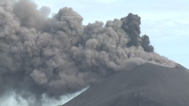 Thick dark ash erupts from crater of Anak Krakatau volcano medium shot, Krakatoa, Indonesia, November 2010