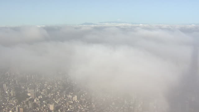 thick fog over tokyo, shot from skytree, japan - smog video stock e b–roll