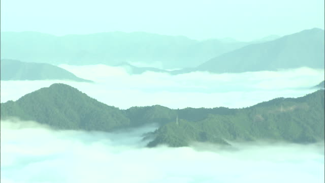 thick fog settles over valleys in japan. - satoyama scenery stock videos & royalty-free footage