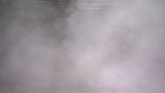 Thick gray/white smoke coming out of coal mine entrance No people Possibly coal fire methane gas Greenhouse Gases Global Warming Environmental Impact...