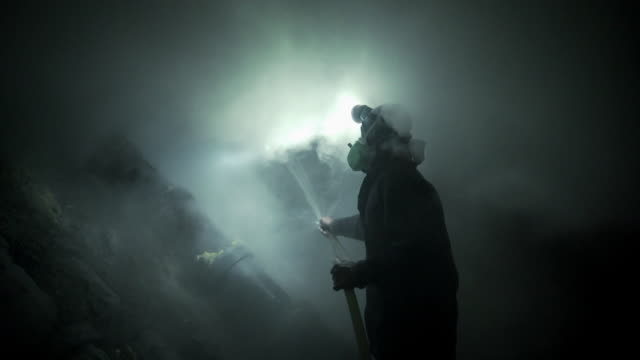thick green smoke envelops a firefighter - toxic substance stock videos & royalty-free footage