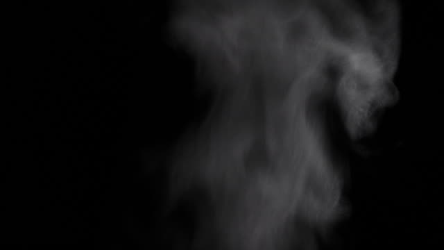 Thick hot steam on a black background