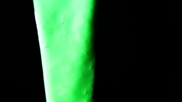 Thick, liquid green goop slides down.