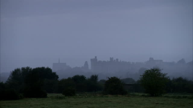 a thick mist obscures the arundel castle. - arundel castle stock videos & royalty-free footage