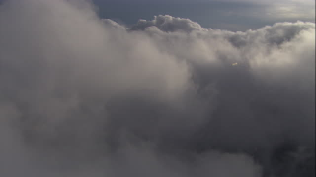 thick, puffy clouds hover in the air. available in hd. - thick stock videos & royalty-free footage