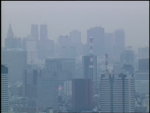 thick smog obscures tokyo. - environmental issues stock-videos und b-roll-filmmaterial