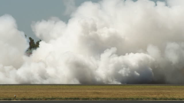 Thick smoke from jet cars on tarmac at Hillsboro Air Show