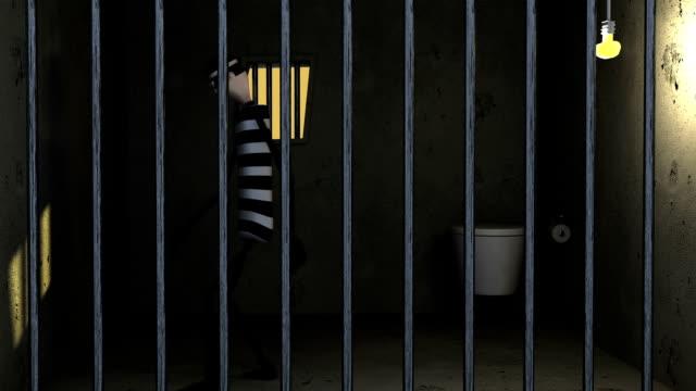 thief behind bars - prisoner walking stock videos & royalty-free footage