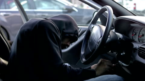 thief hotwiring a car and stealing it - stealing crime stock videos & royalty-free footage
