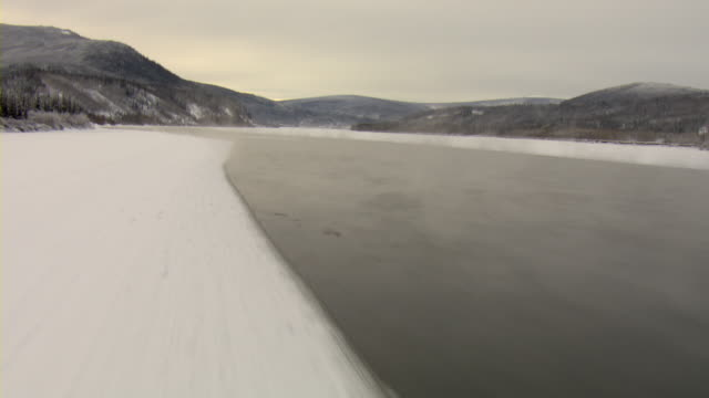 A thin crust of ice covers the Yukon River in Canada.