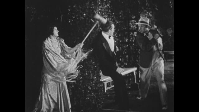 1932 things turn violent when a female impersonator gets hold of a croquet mallet - look alike stock videos and b-roll footage
