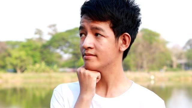 stockvideo's en b-roll-footage met denken, portret van jonge mannen - alleen één tienerjongen