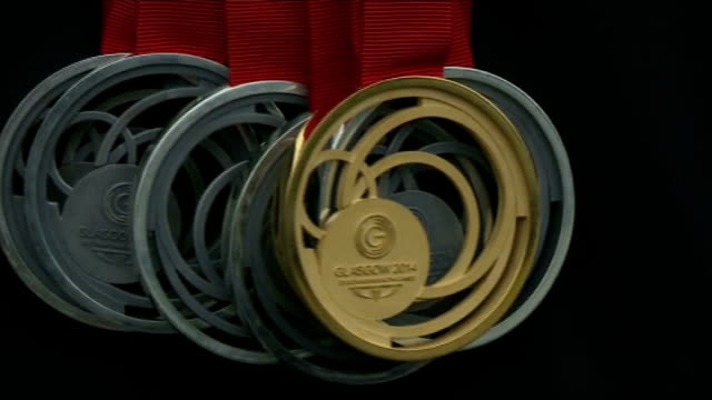 Third day of competition EXT Close up shot medals including Commonwealth Games gold medal Frankie Jones interview SOT