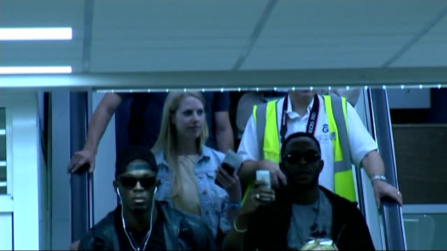 third day of competition scotland glasgow glasgow airport int usain bolt down escalator and giving 'thumbs up' sign - glasgow international airport stock videos & royalty-free footage