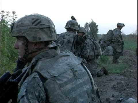 third infantry division us soldiers patrolling field at dawn / arab jabour iraq / audio - 2007 stock videos & royalty-free footage