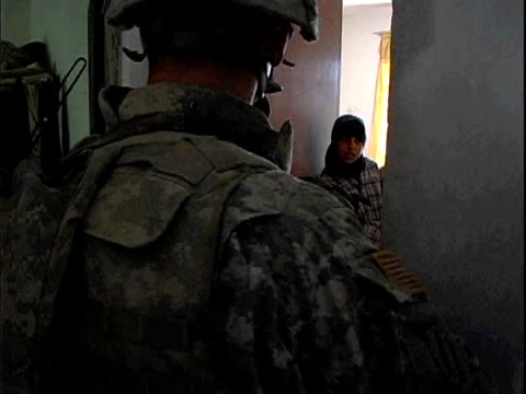 Third Infantry Division US soldiers questioning woman and girls in their home / Arab Jabour Iraq / AUDIO