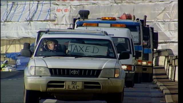 third letter bomb sent to vehicle licensing headquarters in swansea tx car at head of fuel protest convoy towards as putting 'taxed out of work' sign... - anweisungen geben stock-videos und b-roll-filmmaterial