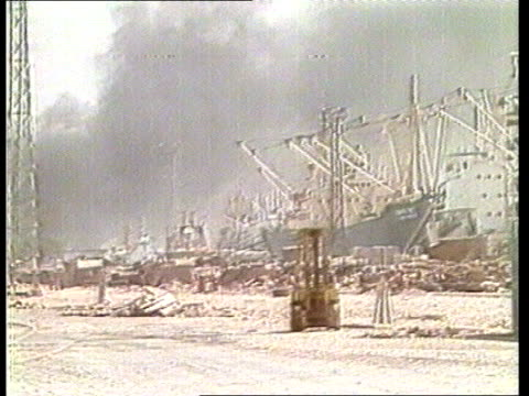 third week iran khorramshahr ext gv dock anchored ships zoom sof of gun barrage zoom smoke rising bv anchored ships pall of smoke shed in foreground... - anchored stock videos & royalty-free footage