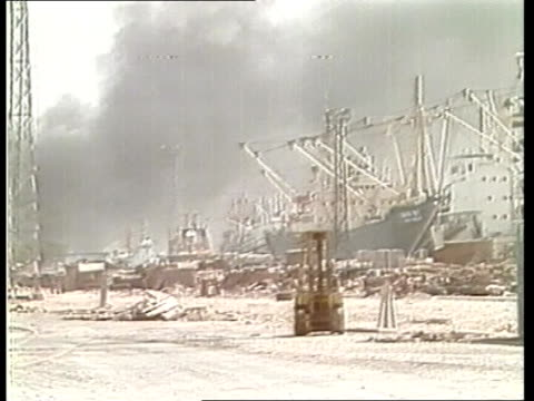 third week iran khorramshahr gv dock anchored ships zoom sof of gun barrage zoom smoke rising bv anchored ships pall of smoke shed in foreground gv... - イラン点の映像素材/bロール