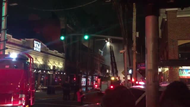 third-alarm fire at a nightclub in ybor city, tampa, has been blamed on welding work inside the building. - fire protection suit stock videos & royalty-free footage
