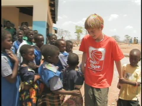 thirteenyearold arizonan austin gutwein visits with zambian aids orphans - pre adolescent child stock videos & royalty-free footage
